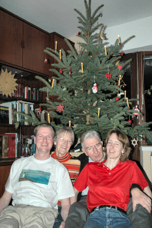 Picture of the Grewe family in front of their Christmas tree