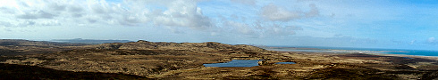 Panoramic view over a wide landscape with two sea lochs