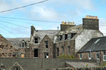 Picture of the back of a dilapidated building, the back of former Islay Hotel in Port Ellen