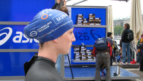 Picture of a young woman (Mhairi Muir) with a swimming cap, just before the start to a race