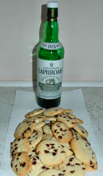 Picture of a pile of shortbread with a bottle of Laphroaig Islay Single Malt