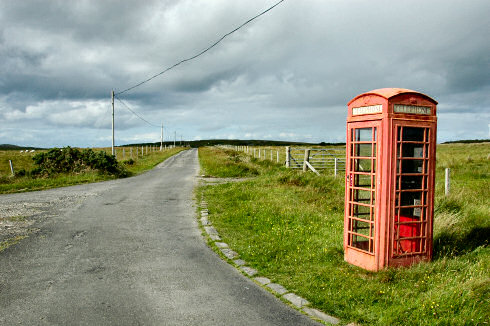 Picture of a single track road on Islay with a phonebox next to it