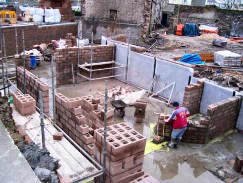 Picture of a building site, the basement of a larger building under construction
