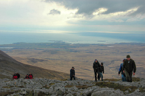 Picture of walkers arriving at the summit of a hill (Beinn Bheigier on Islay)