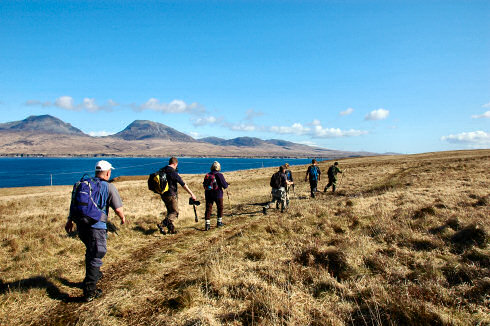 Picture of a group of walkers along the Sound of Islay with the Paps of Jura in the background