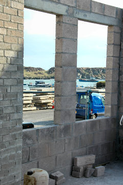 Picture of a view through window holes to a harbour