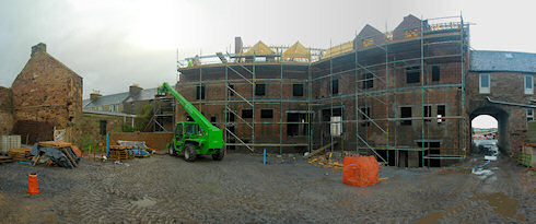 Panoramic picture of the back of the under construction Islay Hotel in Port Ellen