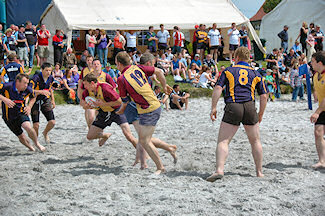 Picture of beach rugby in full action