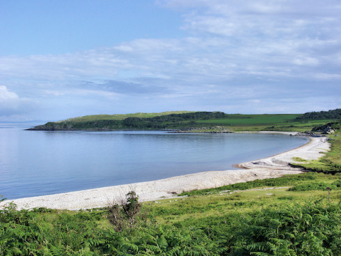 Picture of a bay with a pebble beach on a calm and sunny July evening
