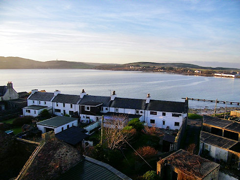 Picture of a view over a bay in the winter afternoon sunshine