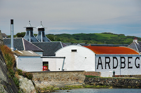 Picture of Ardbeg distillery seen from the rocky shore to the west of the distillery