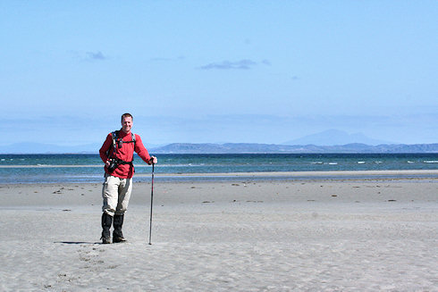 Picture of a walker on a wide beach