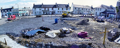 Panoramic picture of a view over a village square being refurbished