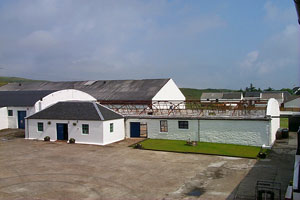 Picture of distillery buildings at Bruichladdich, one without a roof