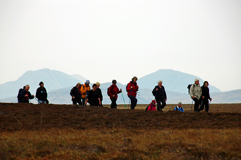 Picture of walkers in a wild landscape, hills in the background