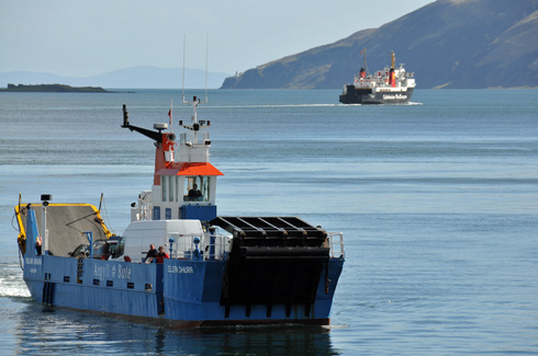 Picture of two ferries in a sound between two islands