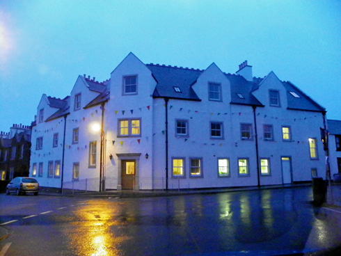 Picture of a hotel decorated with buntings on a rainy October evening