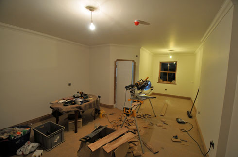 Picture of a view into a hotel bedroom being fitted out