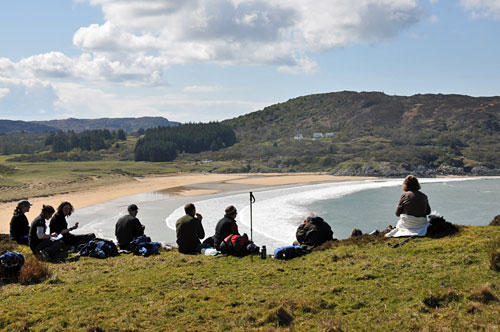 Picture of walkers taking a break with a view of a sandy bay