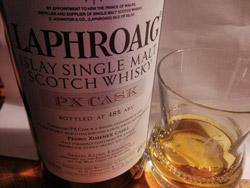 Small picture of a bottle of Laphroaig PX cask with a wee dram next to it